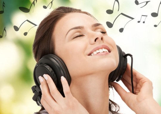 Girl Listening to Happy Music using Headphones