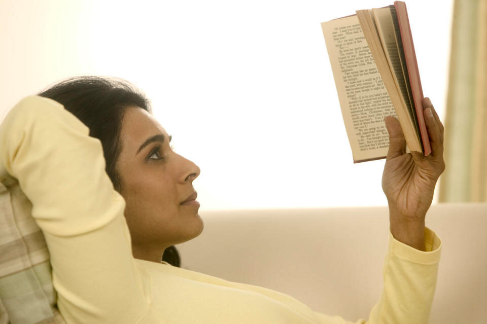 Women Reading a Book in Bed