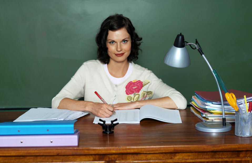 A Female Teacher sitting at her Desk